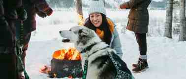 Gather-around-the-fire-on-a-dogsled-tour-at-Spray-Lakes